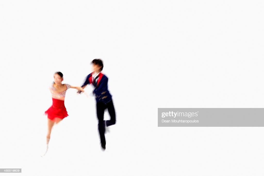 Qing Pang and Jian Tong of China perform in the Paris Free Skating during day two of Trophee Eric Bompard ISU Grand Prix of Figure Skating 2013/2014 at the Palais Omnisports de Bercy on November 16, 2013 in Paris, France.