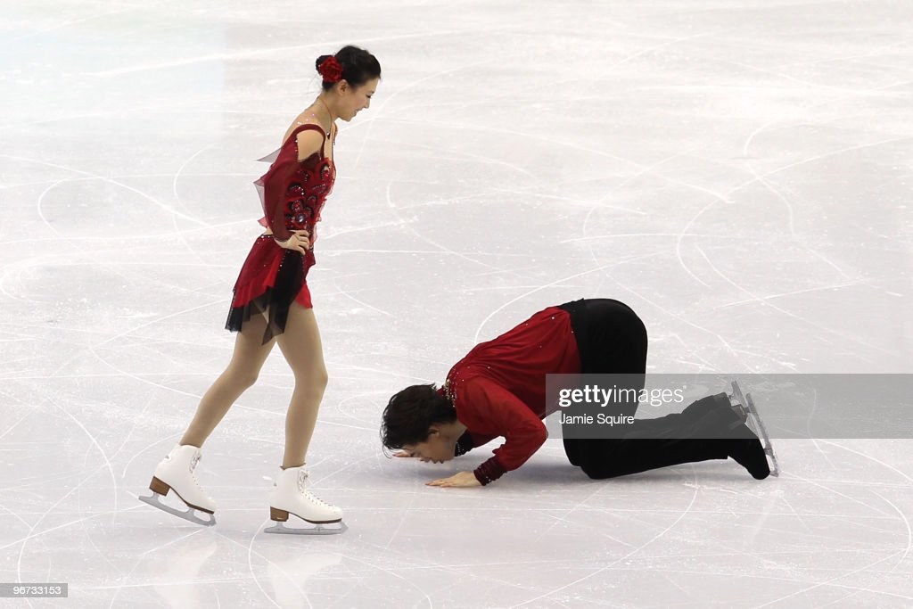 Qing Pang (L) and Jian Tong of China react after competing in the Figure Skating Pairs Free Program on day 4 of the Vancouver 2010 Winter Olympics at the Pacific Coliseum on February 15, 2010 in Vancouver, Canada.