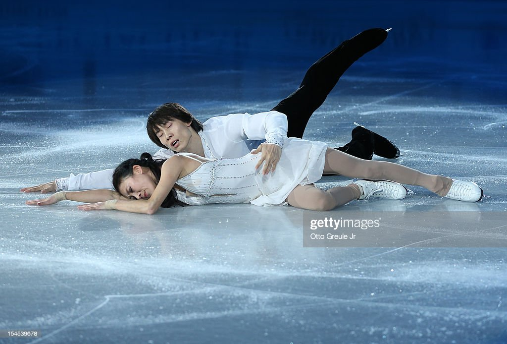 Qing Pang & Jian Tong of China end their routine in the Smucker's Skating Spectacular event during the Skate America competition at the ShoWare Center on October 21, 2012 in Kent, Washington.