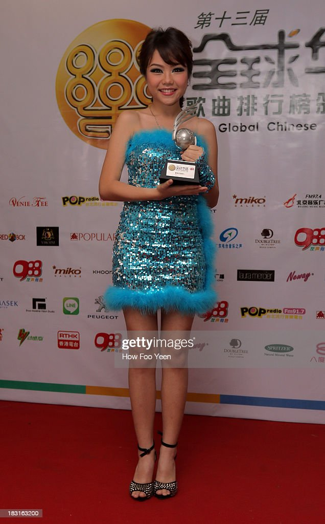 Qing Xi of China poses with her Award at back stage during the 13th Global Chinese Music Awards at Putra Stadium on October 5, 2013 in Kuala Lumpur, Malaysia.