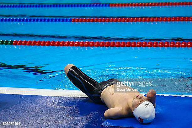 Qing Xu of China rests after competing at the Mens 200m Individual Medley SM6 Final during day 5 of the Rio 2016 Paralympic Games at the Olympic...