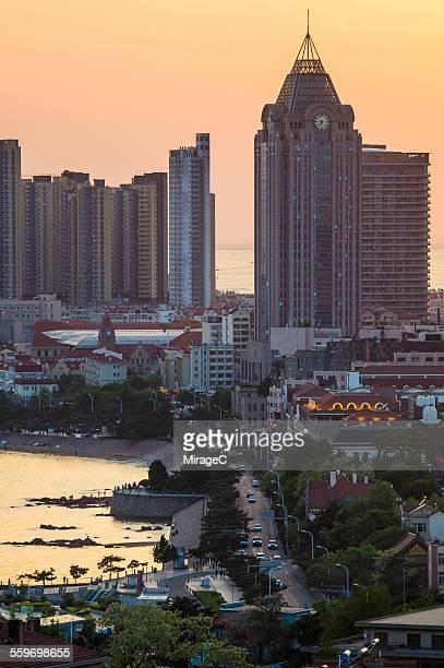Qingdao bay skyline sunset scene