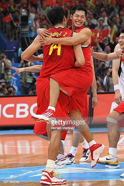 Qingpeng Zhang and Wang Zhizhi of China celebrate on the court after winning the gold medal by defeating South Korea 7771 in the men's gold medal...