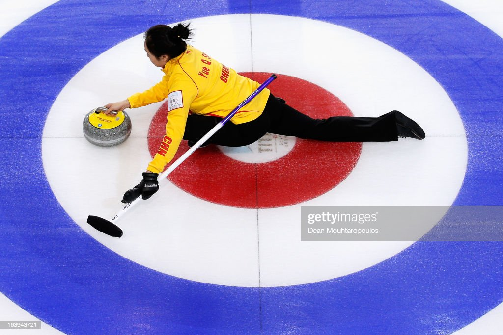 Qingshuang Yue of China releases the stone in the match between China and Italy during Day 3 of the Titlis Glacier Mountain World Women's Curling Championship at the Volvo Sports Centre on March 18, 2013 in Riga, Latvia.