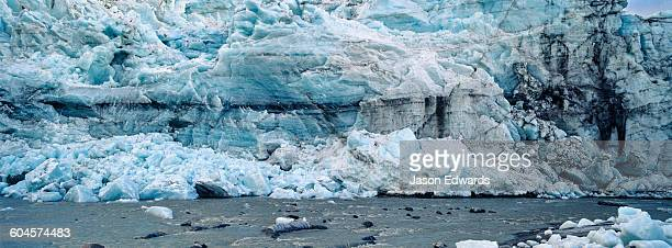 A river flowing along the fracture zone of an enormous glacier.