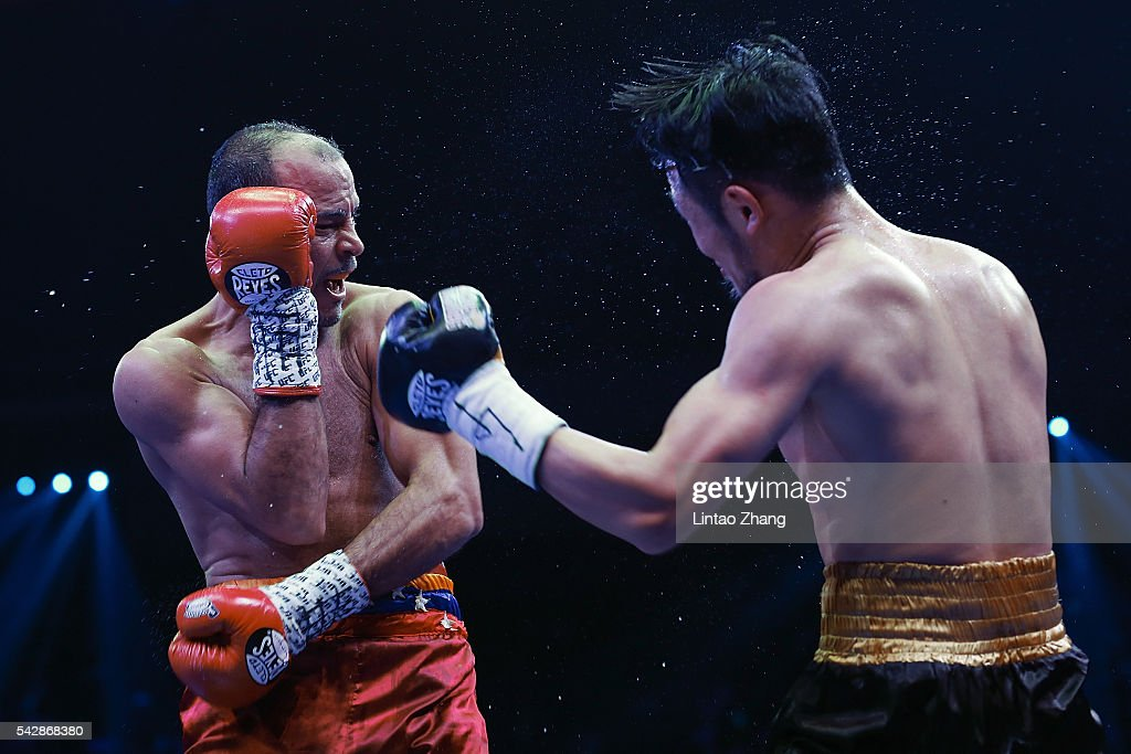 Qiu Xiaojun of China delivers a punch to Nehomar Cermeno of Venezuela during their WBA world super bantamweight championship belt match at Capital Indoor Stadium on June 24, 2016 in Beijing, China.
