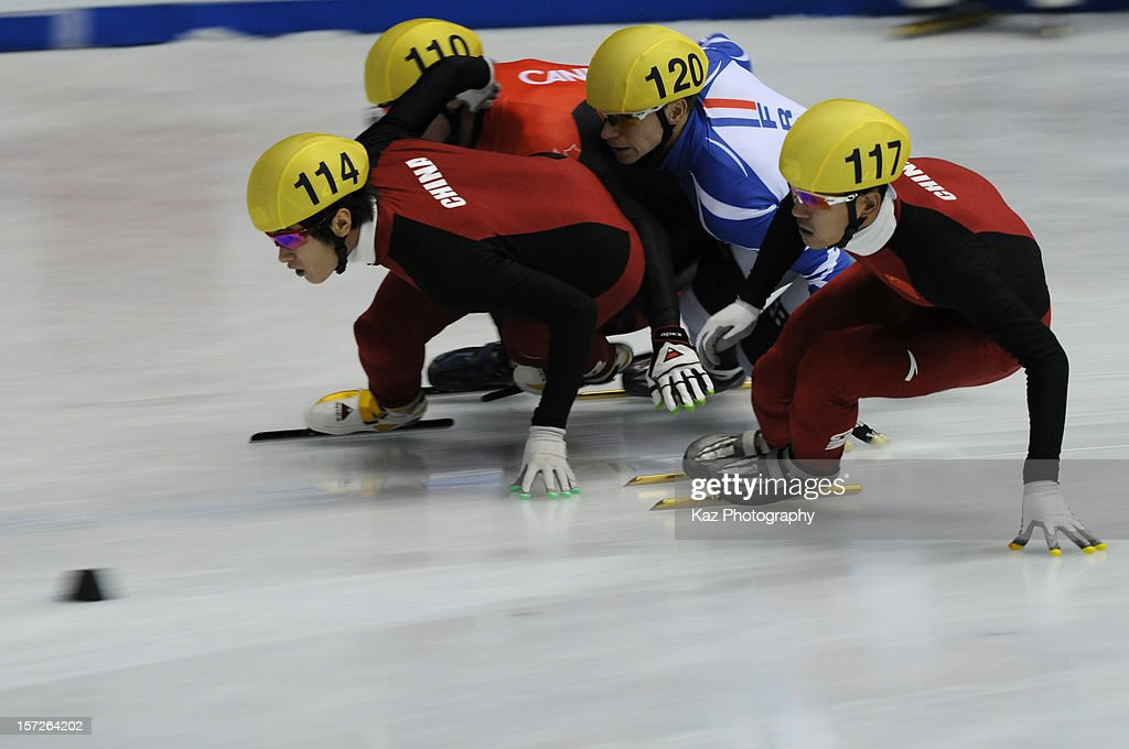 Qiuwen Gong of China goes ahead of <a gi-track='captionPersonalityLinkClicked' href=/galleries/search?phrase=Francois+Hamelin&family=editorial&specificpeople=4863975 ng-click='$event.stopPropagation()'>Francois Hamelin</a> of Canada, <a gi-track='captionPersonalityLinkClicked' href=/galleries/search?phrase=Maxime+Chataignier&family=editorial&specificpeople=504686 ng-click='$event.stopPropagation()'>Maxime Chataignier</a> of France and Yongjun Yu of China in Race 1 of Men 1500m Semifinals ring day two of the ISU World Cup Short Track at Nippon Gaishi Arena on December 1, 2012 in Nagoya, Japan.