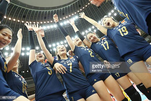 Qiuyue Wei of China celebrates with her teammate after victory the match between Japan and China during the FIVB Women's Volleyball World Cup Japan...