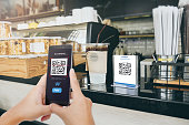 Qr code payment, E wallet , cashless technology concept. Man scaning  tag in Coffee shop accepted generate digital pay without money.Qr code payment, E wallet , cashless technology concept. Man scanni