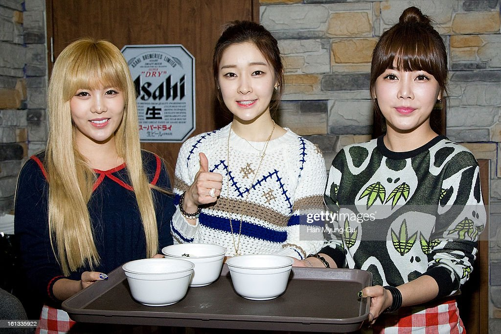 Qri, Areum and Soyeon (So-Yeon) of South Korean girl group T-ara pose for media during as hold tteokguk (rice-cake soup) the Core Contents Media Artists New Year's Day Charity Event at Gibalhan Chicken Store on February 9, 2013 in Bucheon, South Korea.