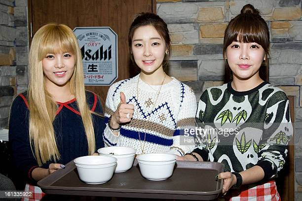 Qri Areum and Soyeon of South Korean girl group Tara pose for media during as hold tteokguk the Core Contents Media Artists New Year's Day Charity...