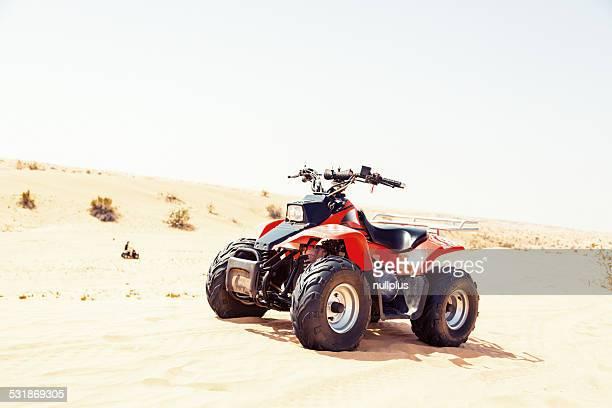 quad bike on sand dune