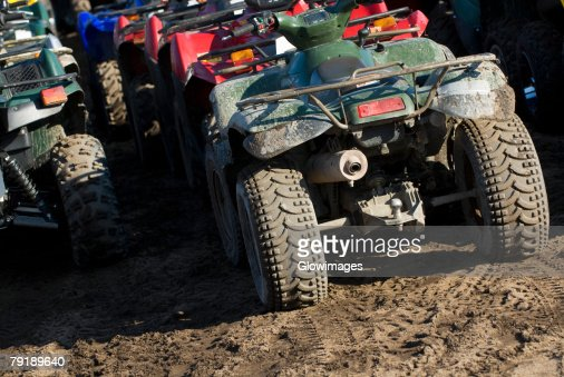 Quadbikes parked in a row : Foto de stock