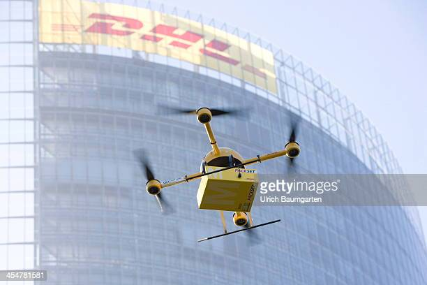 A quadcopter drone with a small delivery flies at the Deutsche Post/DHL headquarters on December 10 2013 in Bonn Germany Deutsche Post/DHL is...