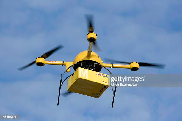 A quadcopter drone with a small delivery starts it's journey over the river Rhine to the Deutsche Post/DHL headquarters on December 9 2013 in Bonn...