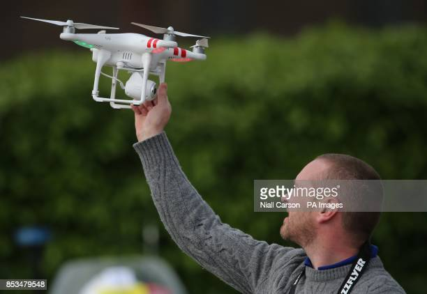 A quadcopter type drone with a camera is being operated in Belfast