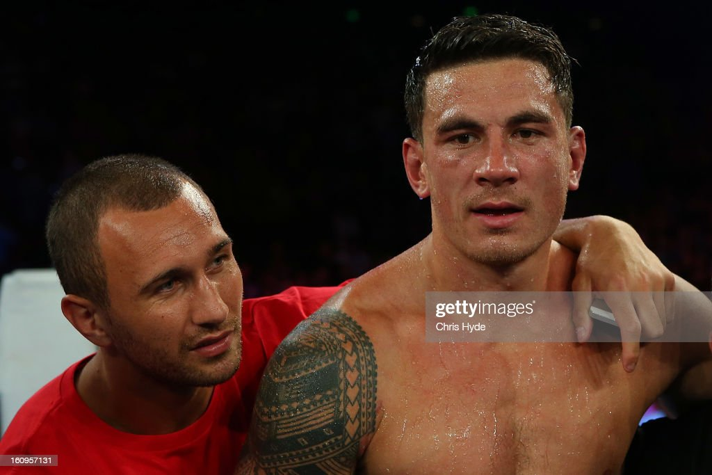 Quade Cooper congratulates Sonny Bill Williams after winning his fight against Francois Botha in their heavyweight bout at the Brisbane Entertainment Centre on February 8, 2013 in Brisbane, Australia.