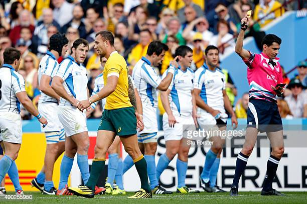Quade Cooper of Australia leaves the field after being shown a yellow card by referee Pascal Gauzere during the 2015 Rugby World Cup Pool A match...