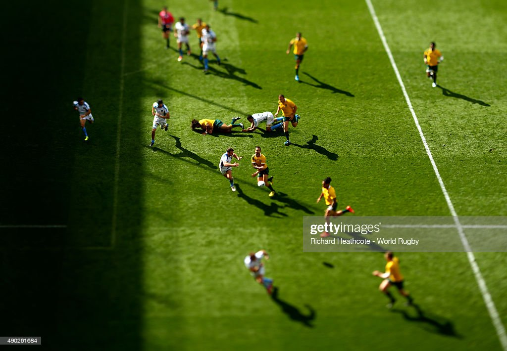 <a gi-track='captionPersonalityLinkClicked' href=/galleries/search?phrase=Quade+Cooper&family=editorial&specificpeople=4176008 ng-click='$event.stopPropagation()'>Quade Cooper</a> of Australia passes the ball towards Drew Mitchell who runs in to score a try during the 2015 Rugby World Cup Pool A match between Australia and Uruguay at Villa Park on September 27, 2015 in Birmingham, United Kingdom.