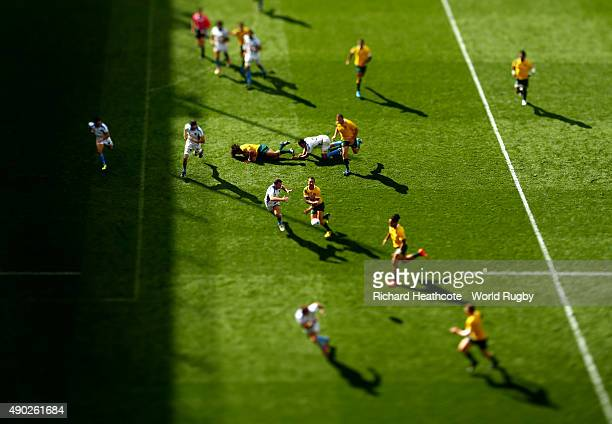 Quade Cooper of Australia passes the ball towards Drew Mitchell who runs in to score a try during the 2015 Rugby World Cup Pool A match between...