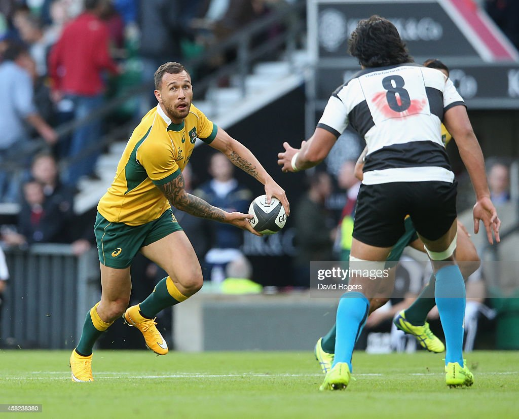 <a gi-track='captionPersonalityLinkClicked' href=/galleries/search?phrase=Quade+Cooper&family=editorial&specificpeople=4176008 ng-click='$event.stopPropagation()'>Quade Cooper</a> of Australia runs with the ball during the Killick Cup match between the Barbarians and Australian Wallabies at Twickenham Stadium on November 1, 2014 in London, England.