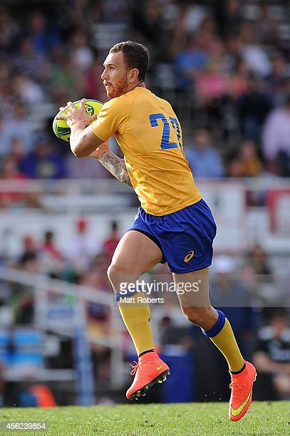 Quade Cooper of Brisbane City receivces a pass during the round six NRC match between Brisbane City and Queensland Country at Ballymore Stadium on...
