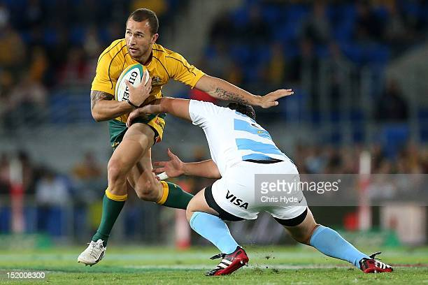 Quade Cooper of the Australian Wallabies is tackled during the Rugby Championship match between the Australian Wallabies and Argentina at Skilled...