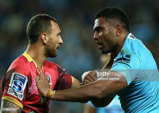 Quade Cooper of the Reds and Wycliff Palu of the Waratahs exchange words during the round 18 Super Rugby match between the Waratahs and the Reds at...