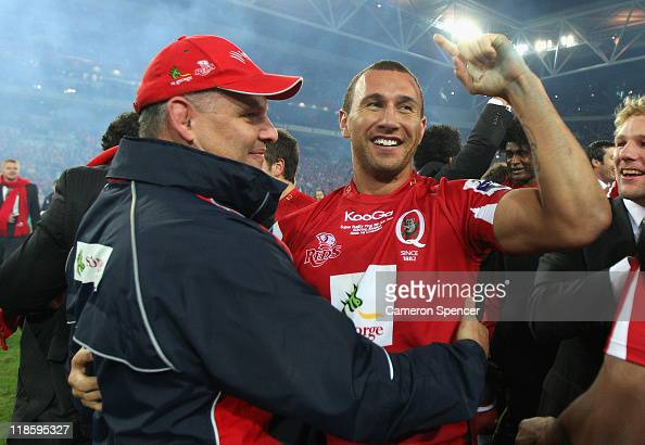 Quade Cooper of the Reds celebrates with coach Ewen McKenzie after winning the 2011 Super Rugby Grand Final match between the Reds and the Crusaders...