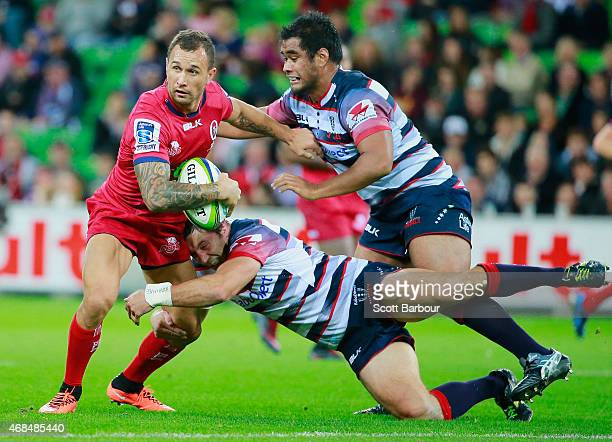 Quade Cooper of the Reds is tackled during the round eight Super Rugby match between the Rebels and the Reds at AAMI Park on April 3 2015 in...