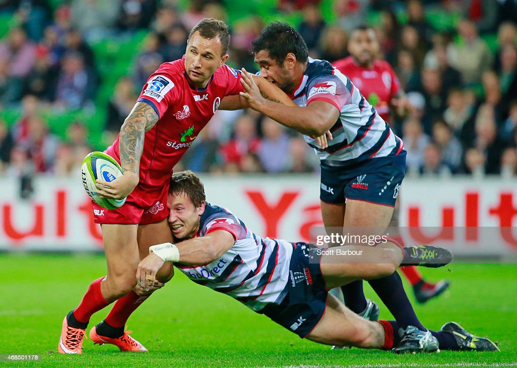 <a gi-track='captionPersonalityLinkClicked' href=/galleries/search?phrase=Quade+Cooper&family=editorial&specificpeople=4176008 ng-click='$event.stopPropagation()'>Quade Cooper</a> of the Reds is tackled during the round eight Super Rugby match between the Rebels and the Reds at AAMI Park on April 3, 2015 in Melbourne, Australia.