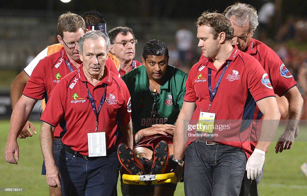 Quade Cooper of the Reds is taken from the field on a stretcher and in a neck brace during the Super Rugby trial match between the Queensland Reds and the Melbourne Rebels at Ballymore Stadium on February 14, 2014 in Brisbane, Australia.