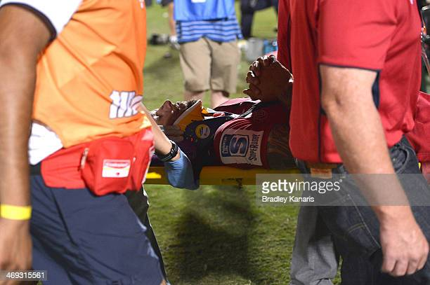 Quade Cooper of the Reds is taken from the field on a stretcher in a neck brace during the Super Rugby trial match between the Queensland Reds and...