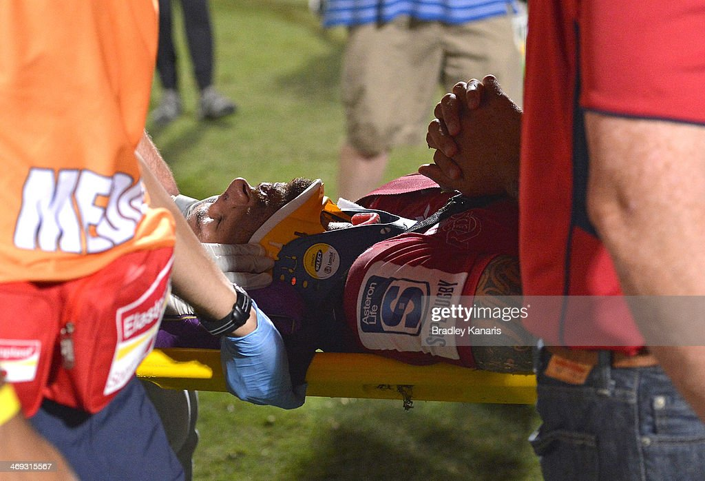 Quade Cooper of the Reds is taken from the field on a stretcher in a neck brace during the Super Rugby trial match between the Queensland Reds and the Melbourne Rebels at Ballymore Stadium on February 14, 2014 in Brisbane, Australia.