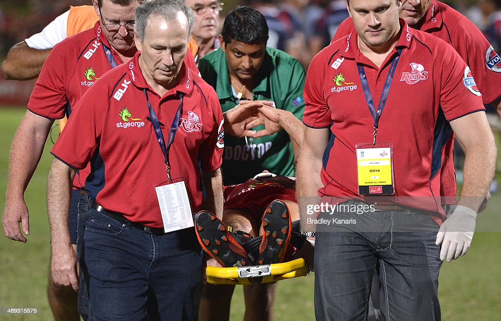 <a gi-track='captionPersonalityLinkClicked' href=/galleries/search?phrase=Quade+Cooper&family=editorial&specificpeople=4176008 ng-click='$event.stopPropagation()'>Quade Cooper</a> of the Reds is taken from the field on a stretcher in a neck brace during the Super Rugby trial match between the Queensland Reds and the Melbourne Rebels at Ballymore Stadium on February 14, 2014 in Brisbane, Australia.