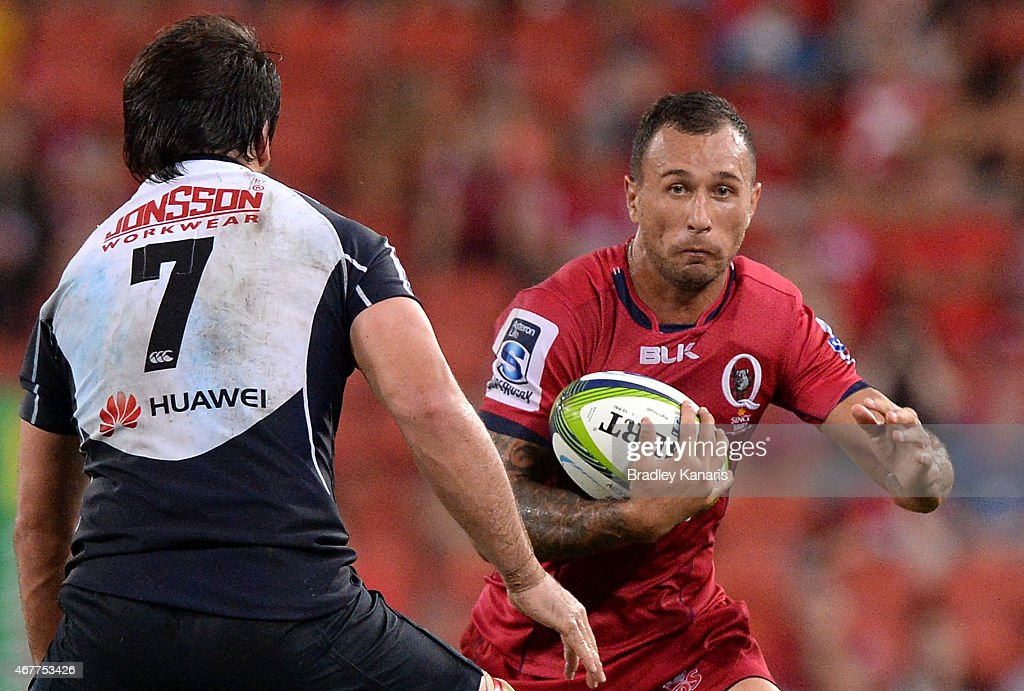 <a gi-track='captionPersonalityLinkClicked' href=/galleries/search?phrase=Quade+Cooper&family=editorial&specificpeople=4176008 ng-click='$event.stopPropagation()'>Quade Cooper</a> of the Reds looks to take on the defence during the round seven Super Rugby match between the Reds and the Lions at Suncorp Stadium on March 27, 2015 in Brisbane, Australia.