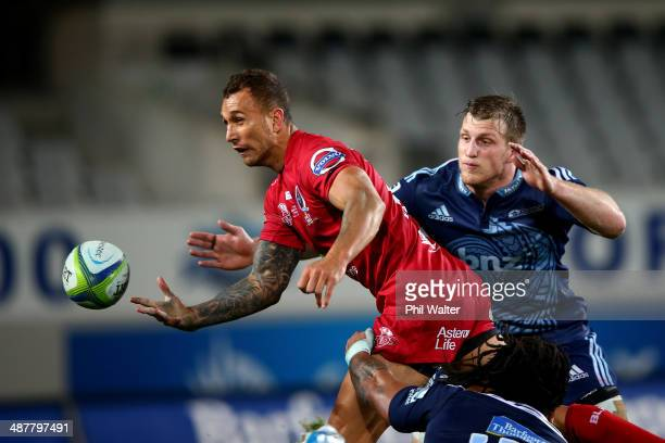 Quade Cooper of the Reds offloads the ball during the round 12 Super Rugby match between the Blues and the Reds at Eden Park on May 2 2014 in...
