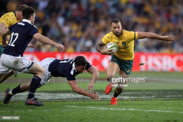 Quade Cooper of the Wallabies evades the tackle of Alex Dunbar of Scotland during the International Test match between the Australian Wallabies and...