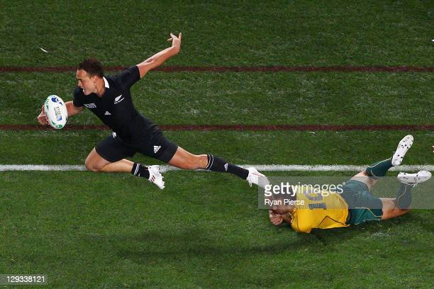 Quade Cooper of the Wallabies fails to stop Israel Dagg of the All Blacks as he breaks forward during semi final two of the 2011 IRB Rugby World Cup...
