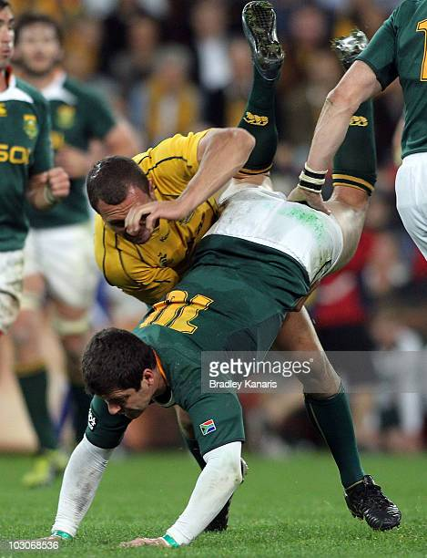 Quade Cooper of the Wallabies lifts Morne Steyn of the Springboks in the tackle during the 2010 TriNations match between the Australian Wallabies and...