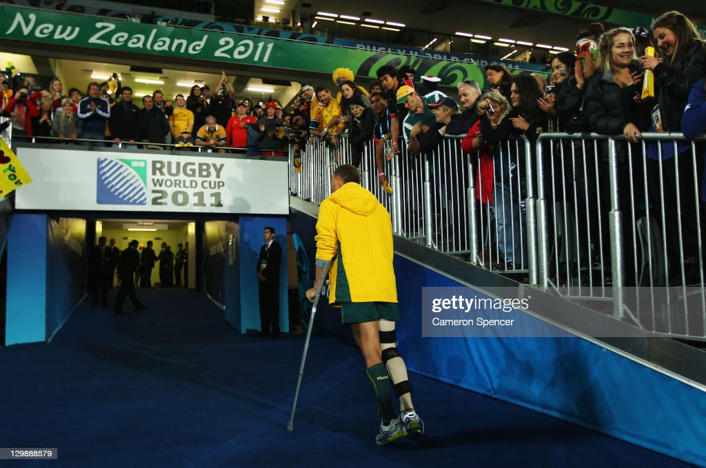 <a gi-track='captionPersonalityLinkClicked' href=/galleries/search?phrase=Quade+Cooper&family=editorial&specificpeople=4176008 ng-click='$event.stopPropagation()'>Quade Cooper</a> of the Wallabies uses crutches to walk down the tunnel after the 2011 IRB Rugby World Cup bronze final match between Wales and Australia at Eden Park on October 21, 2011 in Auckland, New Zealand.
