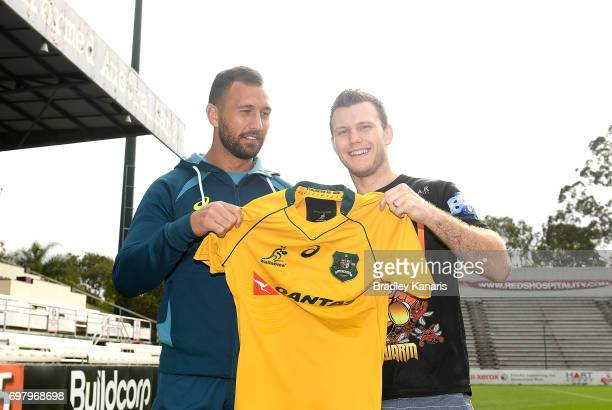 Quade Cooper poses with Jeff Horn during an Australian Wallabies media opportunity at Ballymore Stadium on June 20 2017 in Brisbane Australia