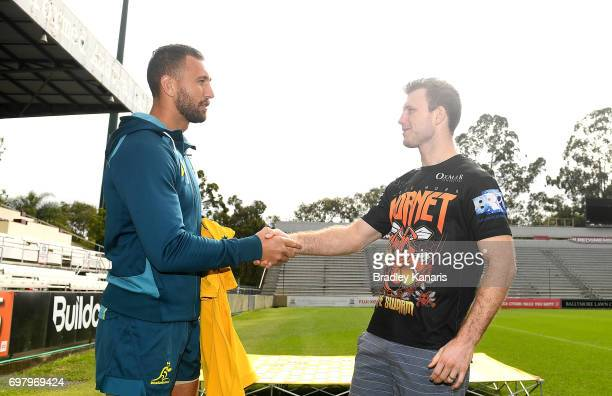 Quade Cooper presents Jeff Horn with a Wallabies jersey during an Australian Wallabies media opportunity at Ballymore Stadium on June 20 2017 in...