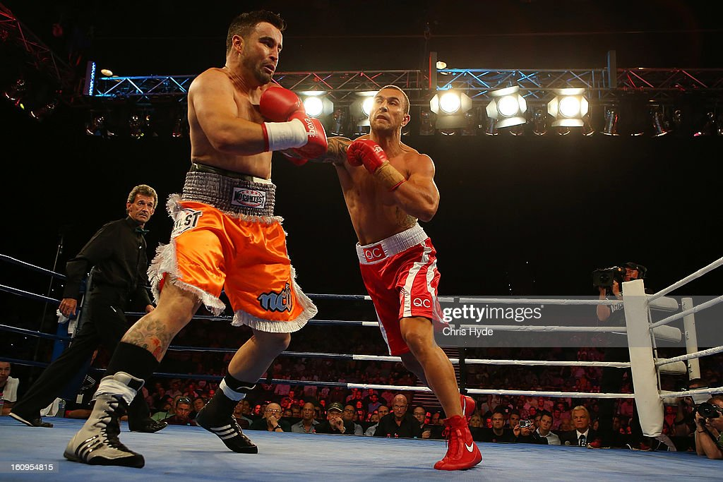 <a gi-track='captionPersonalityLinkClicked' href=/galleries/search?phrase=Quade+Cooper&family=editorial&specificpeople=4176008 ng-click='$event.stopPropagation()'>Quade Cooper</a> punches Barry Dunnett in their cruiserweight fight at the Brisbane Entertainment Centre on February 8, 2013 in Brisbane, Australia.
