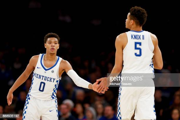 Quade Green of the Kentucky Wildcats celebrates with Kevin Knox after a basket against the Monmouth Hawks during the first half at Madison Square...