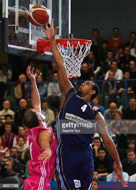 Quadre Lollis of Berlin blocks the shot from Ivan Tomeljak of Bonn during the Bundesliga game between Telekom Baskets Bonn and Alba Berlin at the...
