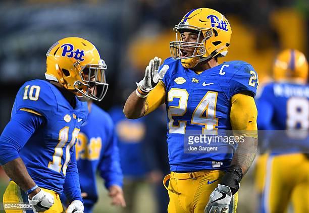 Quadree Henderson of the Pittsburgh Panthers celebrates his punt return for a touchdown with James Conner during the third quarter against the Duke...