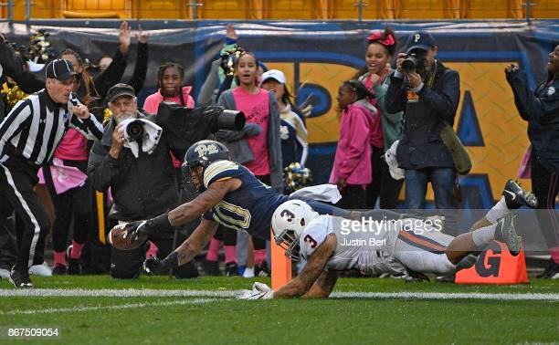 Quadree Henderson of the Pittsburgh Panthers dives into the end zone for a 75 yard punt return touchdown in the second quarter during the game...