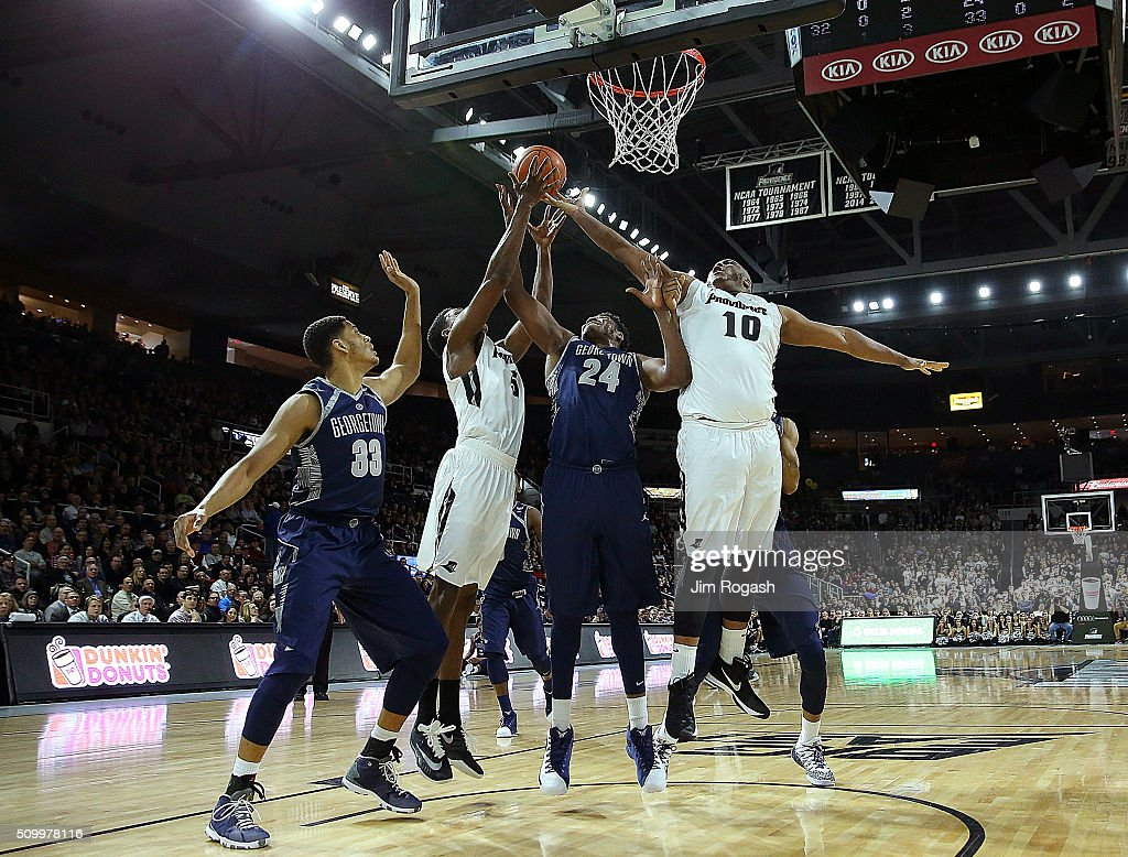 Quadree Smith #10 of the Providence Friars grabs a rebound from the hands of Marcus Derrickson #24 of the Georgetown Hoyas in the first half on February 13, 2016, at the Dunkin' Donuts Center in Providence, Rhode Island.