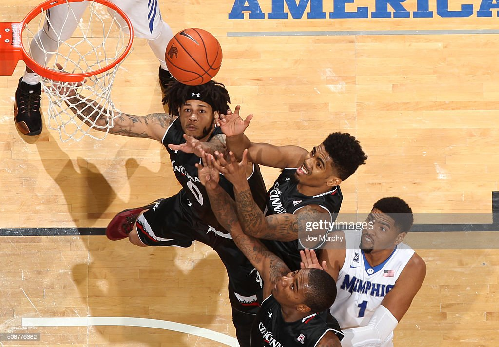 Quadri Moore #0, Jacob Evans #1 and Gary Clark #11 of the Cincinnati Bearcats jump for a rebound against <a gi-track='captionPersonalityLinkClicked' href=/galleries/search?phrase=Dedric+Lawson&family=editorial&specificpeople=13538393 ng-click='$event.stopPropagation()'>Dedric Lawson</a> #1 of the Memphis Tigers on February 6, 2016 at FedExForum in Memphis. Memphis defeated Cincinnati 63-59.